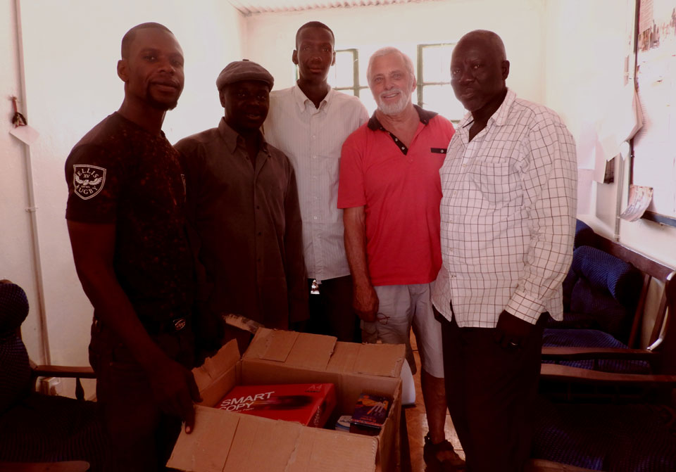 senior teachers, Me and Mr Darboe - HT with school materials I presented