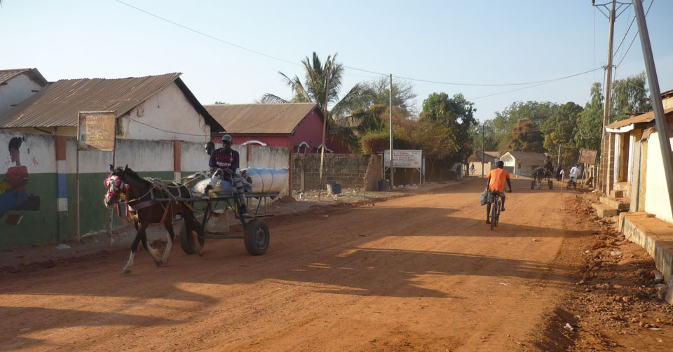 the street in Bansang with a view of Margie's Lodge